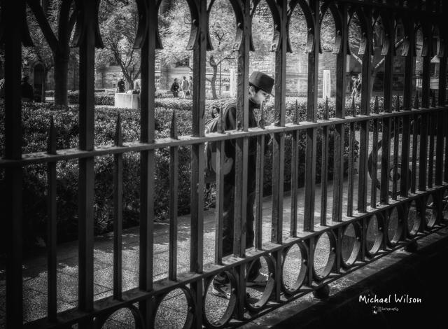 Man through fence